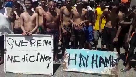 Presos olvidan sus rivalidades y cesan el fuego para protestar por comida, agua y medicinas